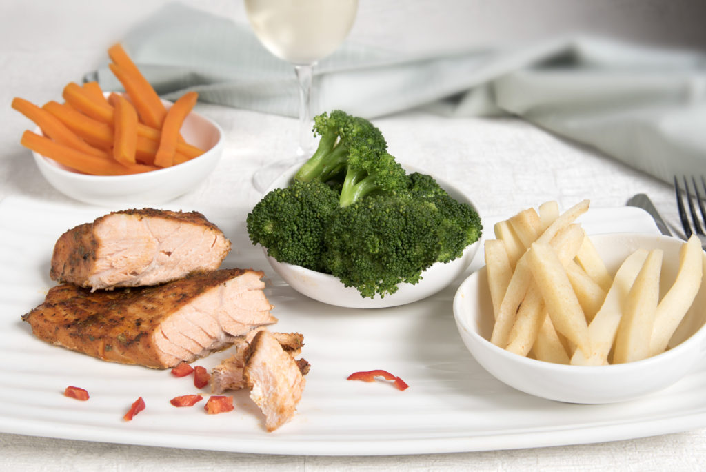 Spiced Salmon with Chips, Broccoli and Carrots
